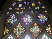 Three glass panels that contain anti-royal stories (they shouldn't have survived the reformation, but did). The middle shows the murder of the cleric Thomas Becket at the bequest of King Henry. These are displayed at a college founded by a cardinal Thomas who was an enemy of a King Henry. It's apparent why their survival is impressive.