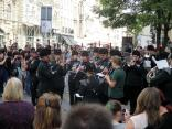 A military band plays in the streets. Neither Bekah or Fletcher know the songs.