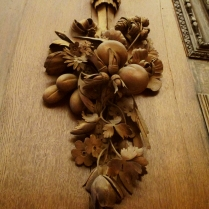 This is carved wood, a design which runs nearly fifty feet in length around the fireplace